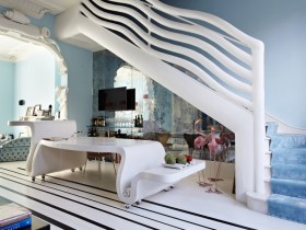 Curvilinear Staircase & White Dining Table designed by Danielle Moudaber (photo by Shootfactory)