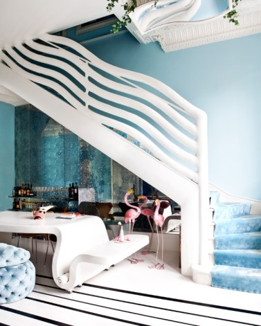 Curvilinear Staircase designed by Danielle Moudaber covered with light blue carpet (photo by Sunna & Marc van Praag)