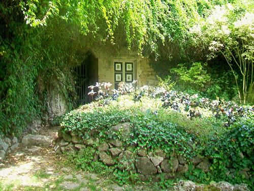 Garden around the door to an underground house Photo by P. Poschadel