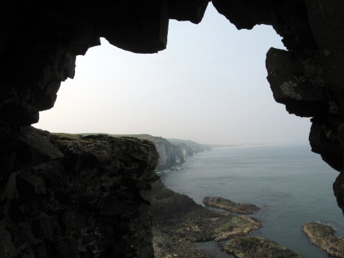 Mermaid's Cave, a huge sea cove beneath Dunluce Castle rock