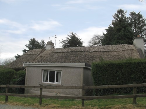Thatched roof being repaired, near Lismore, Ireland