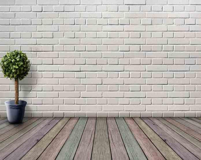 arredamento stile industrial, parete mattoncini