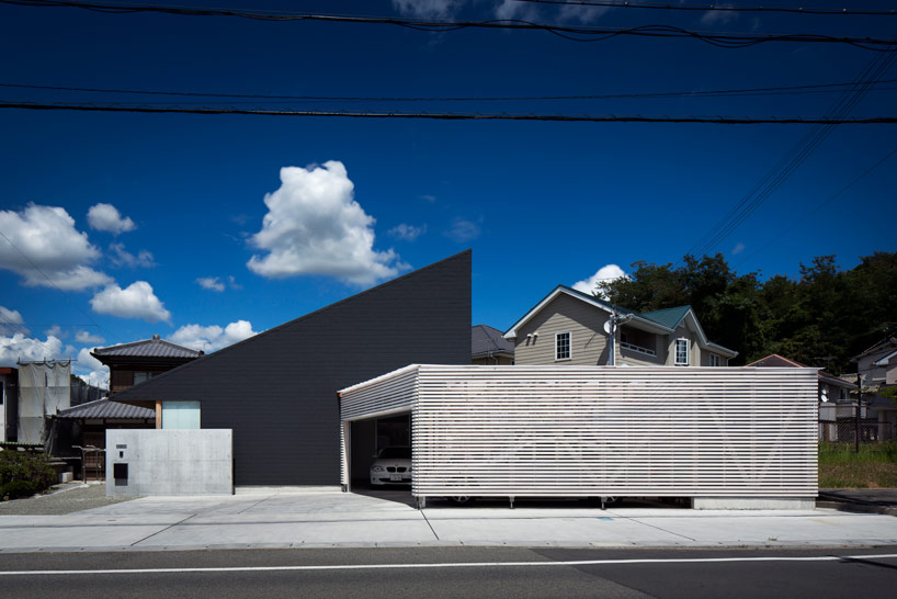 Black Roof House Constructed By Container Design