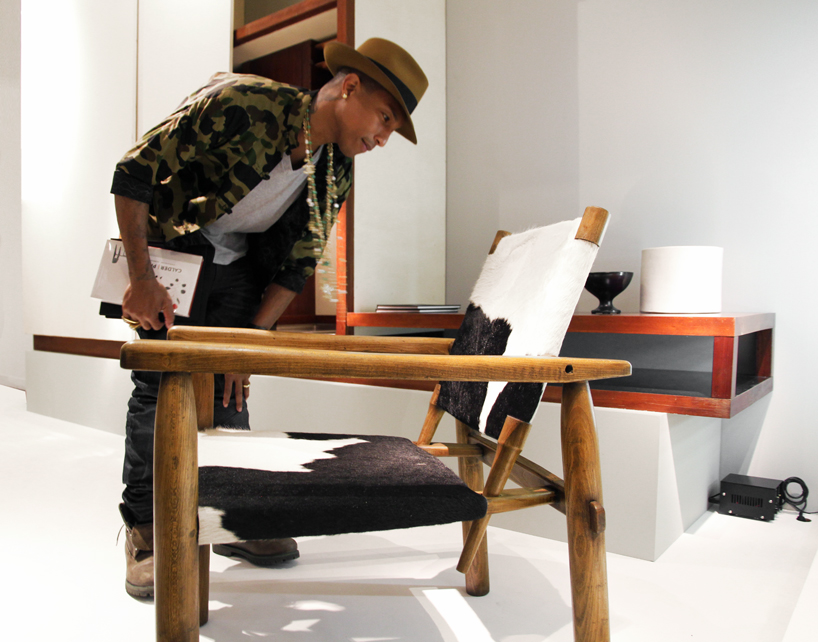 pharrell visits galerie laffanour's charlotte perriand exhibition at design miami