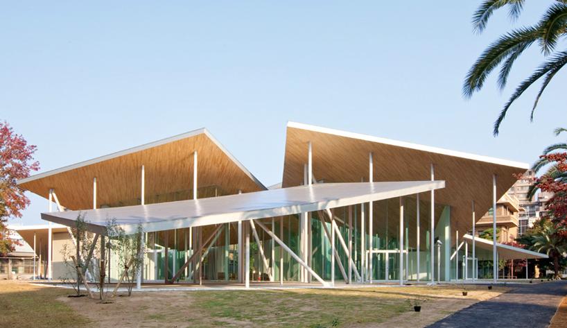 SANAA places junko fukutake hall beneath angled steel roof canopies
