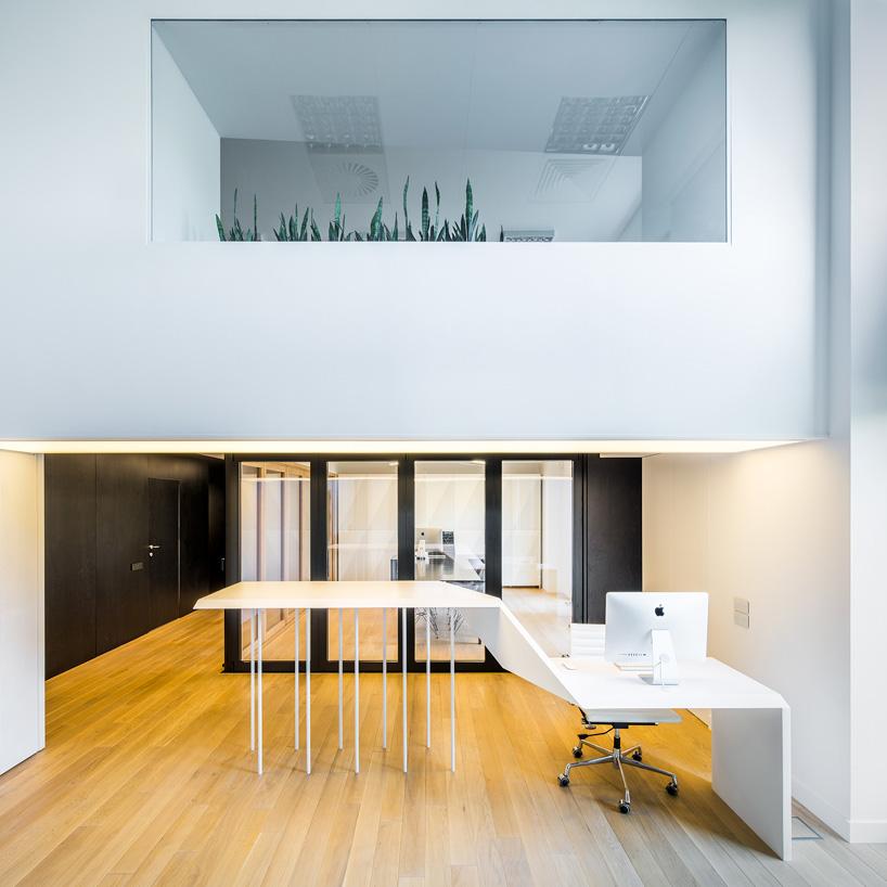 exexe centor headquarters showroom warsaw poland designboom