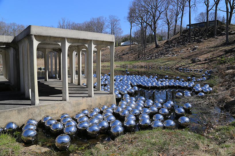 yayoi kusama floats a landscape of 1,300 mirrored spheres at the glass house