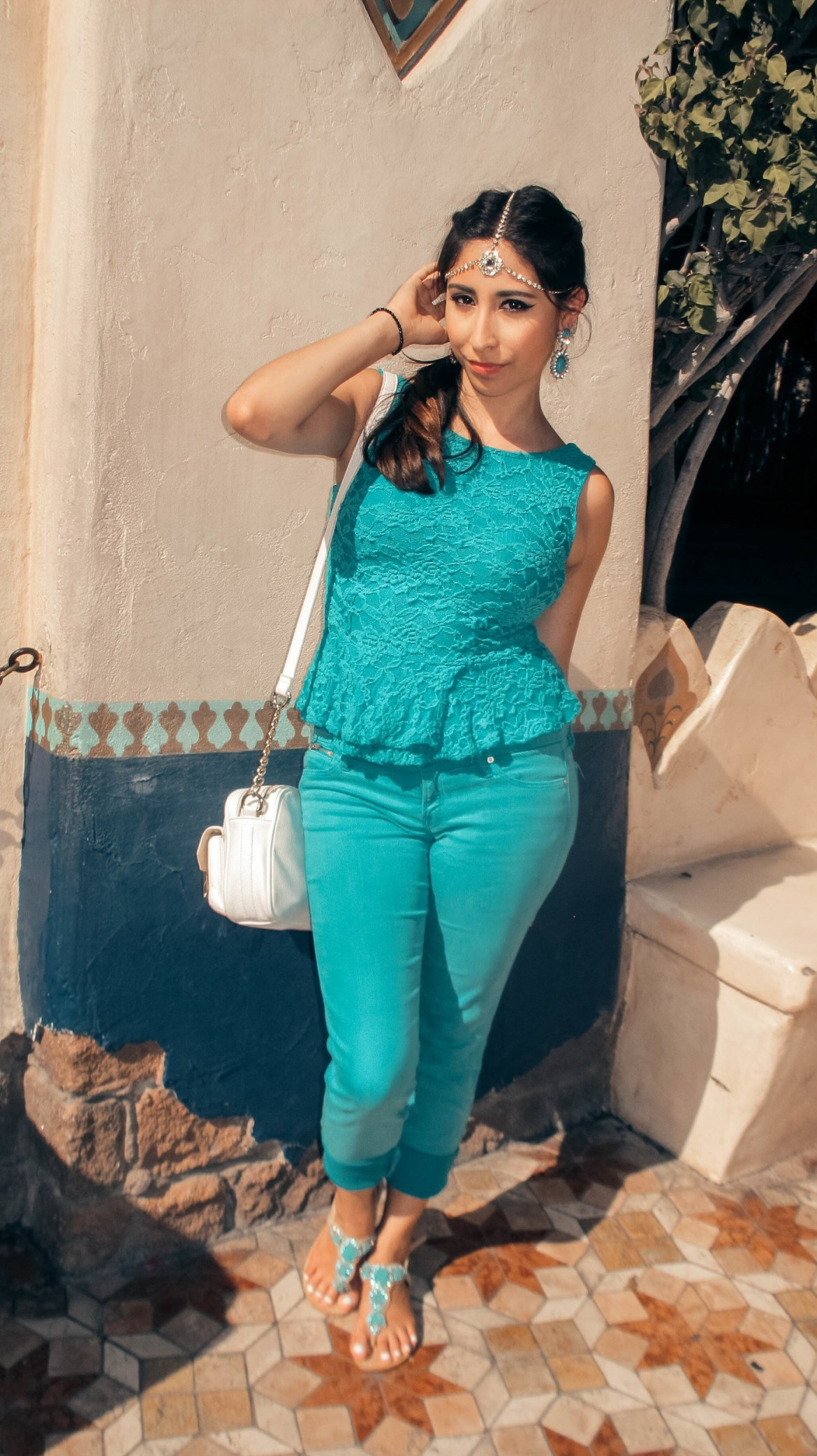 Woman dressed in teal outfit