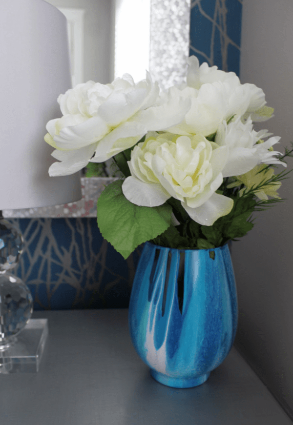 Would you like to know how to make a beautiful painted vase using a paint pouring technique and dollar store supplies. Not only is it easy and inexpensive, but it's really beautiful!