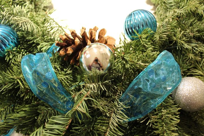 Decorate your fresh cut wreath with dollar store decorations to add that fresh tree smell to your house