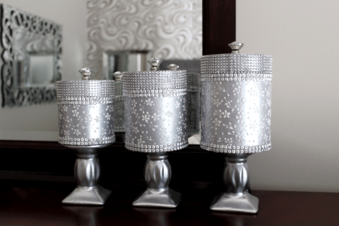 Would you like to see how to make some blingy vanity storage using dollar tree gift boxes? I made a set of three vanity storage containers that work great in the bathroom or bedroom.