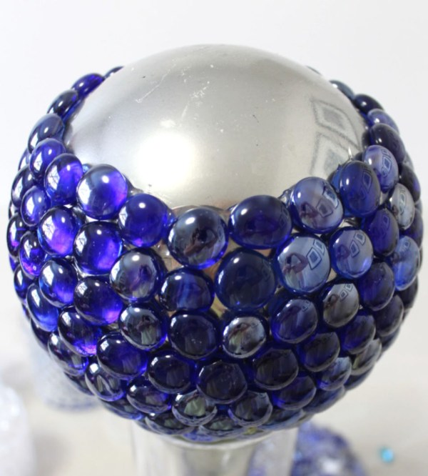 Let me show you how to make these DIY Gazing Balls using glass light globes, mirrored spray paint and stones. Add some DIY Decor to your garden so your landscaping shines. Add them to your flower beds.
