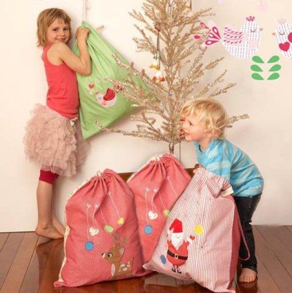 Santa Sacks: Simplify Christmas with a wonderful family tradition! Santa has never left WRAPPED Christmas gifts in our home. Santa leaves gifts in the Santa Sacks to be opened on Christmas morning.