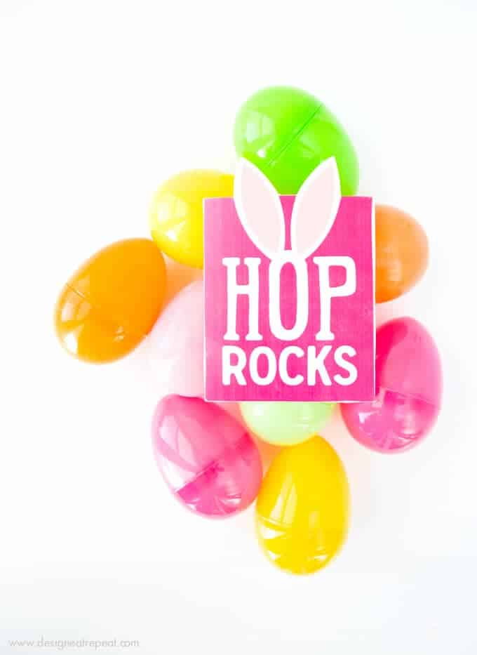 """Need a fun way to spruce up your kid's Easter basket? Print off these Free Easter Printable """"Hop Rock"""" Pouches and add in a packet of pop rocks for a fun surprise!"""