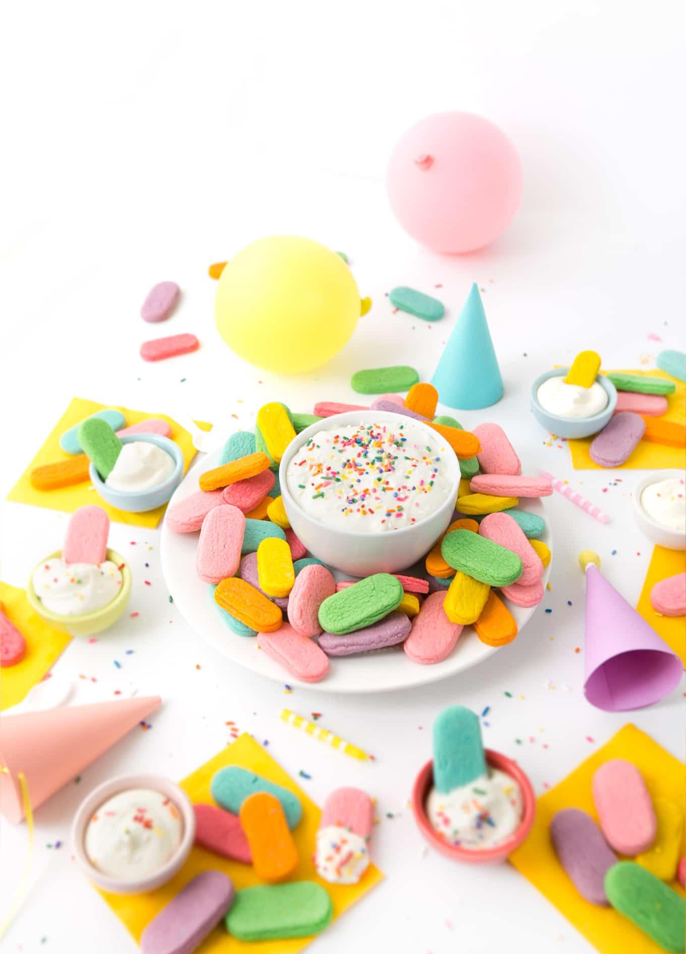 OMG. Sugar cookies shaped like SPRINKLES! Make these sugar cookie dippers as the perfect birthday party treat! | www.DesignEatRepeat.com | #sprinkles #sugarcookie