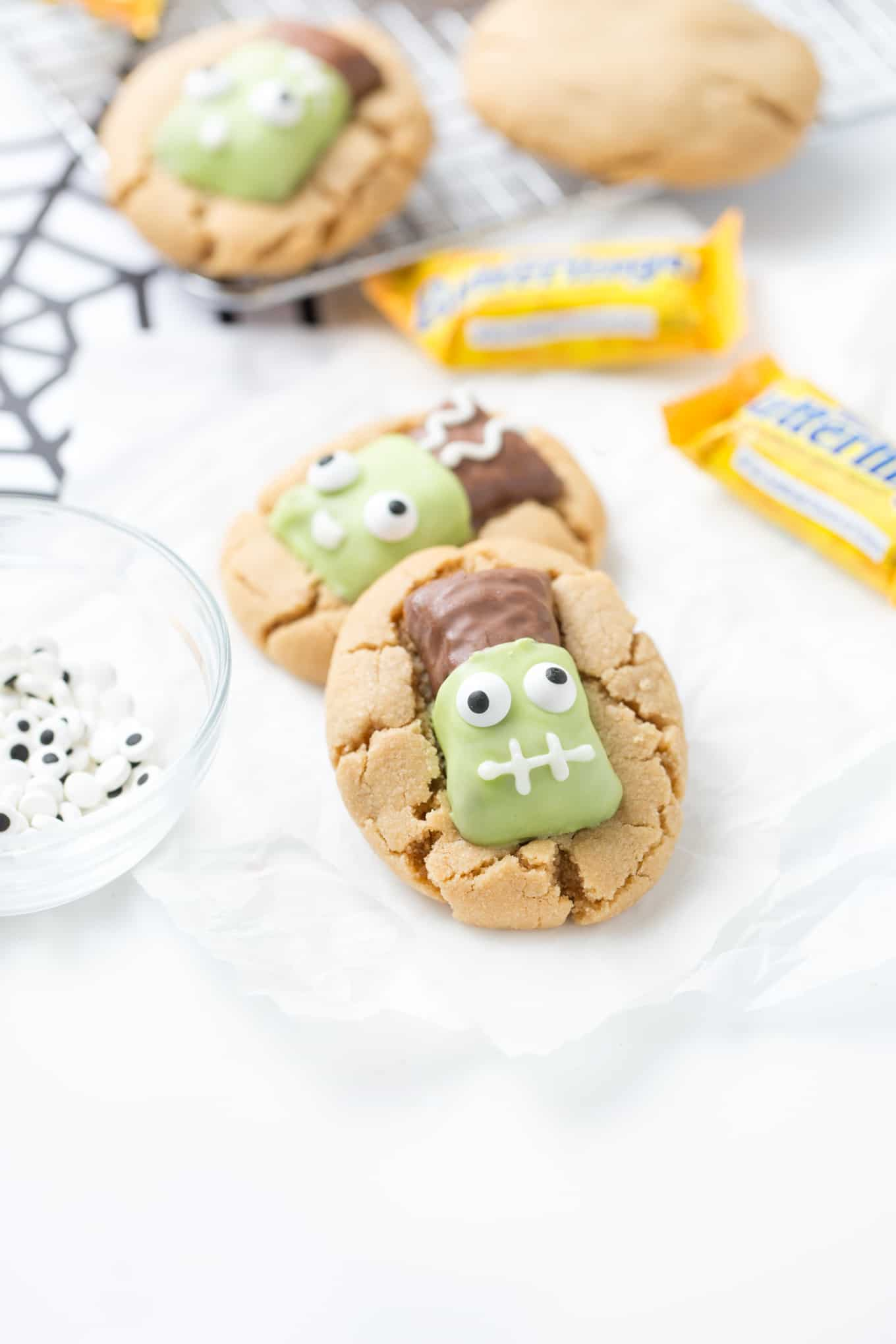 Peanut Butter Cookies topped with Frankenstein Butterfingers Candy Eyeballs