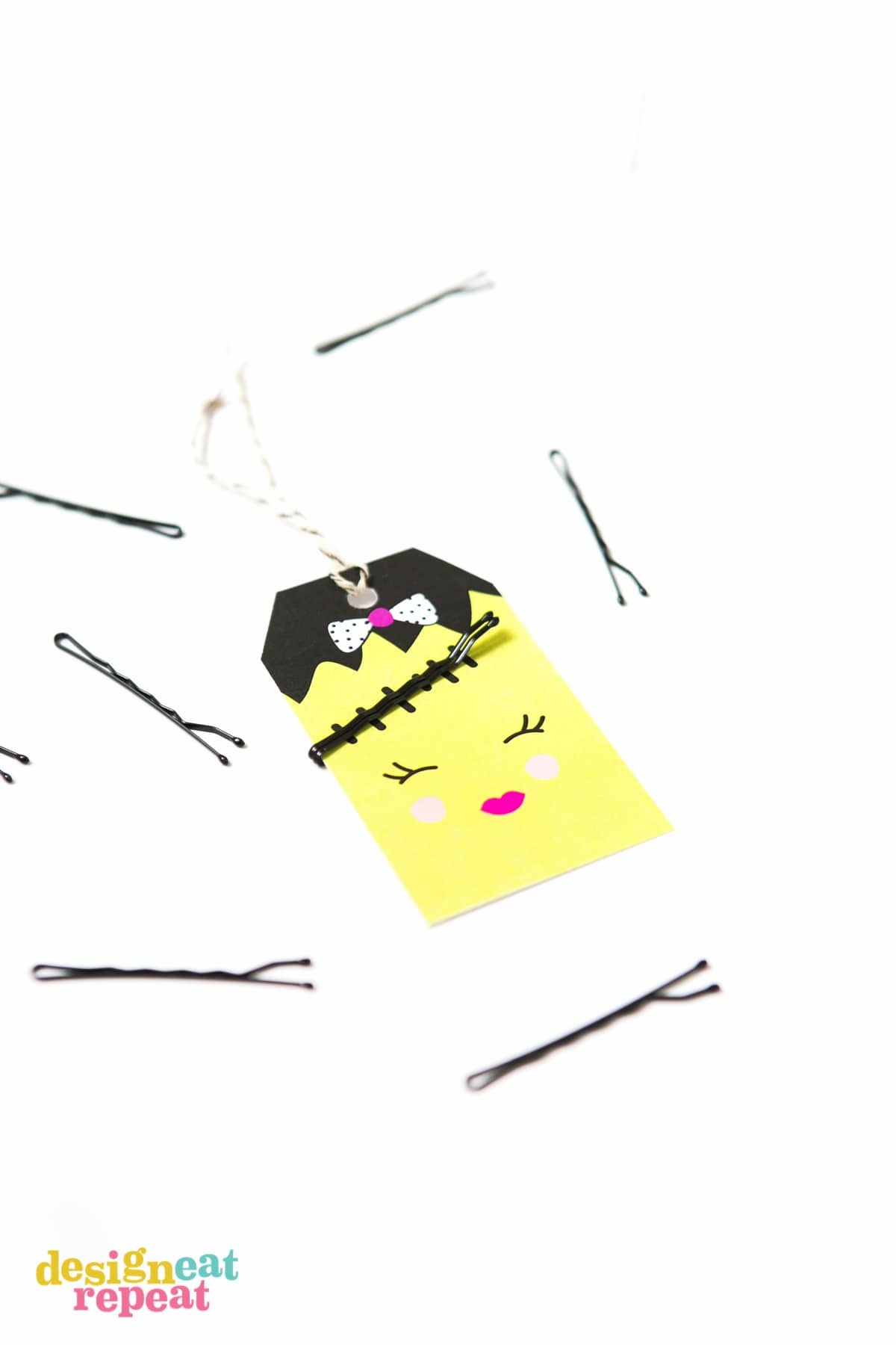 Attach bobby pins to these adorable Halloween tags and help solve the mystery of where the millions of bobby pins across the world disappear to! Download the FREE printable at Design Eat Repeat.