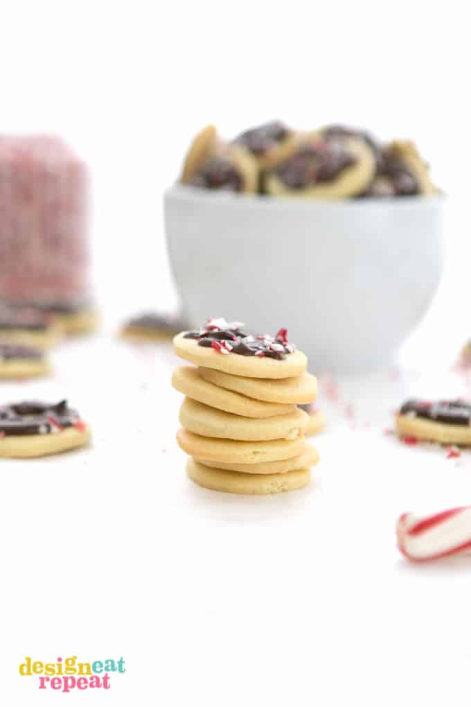 Stack of chocolate peppermint butter wafer cookies with crushed peppermint bits on top.