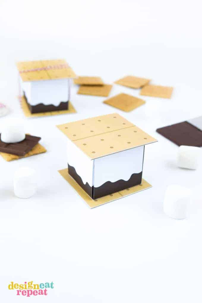 Dive into summer with these FREE S'more Printable Treat Boxes! Perfect for a camping-themed birthday parties, summer barbecues, or just as fun way to spruce up a night of indoor microwave s'mores!