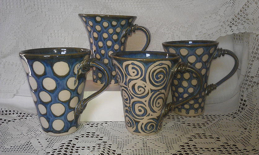Ceramic mugs by Lois Thirkettle