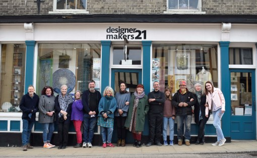 Members pose outside Designer Makers 21 Shop and gallery
