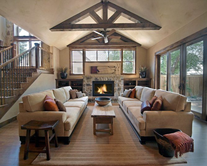 traditional family room with stone fireplace