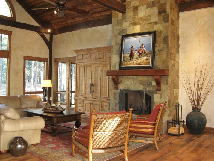 Mountain family room with stone fireplace