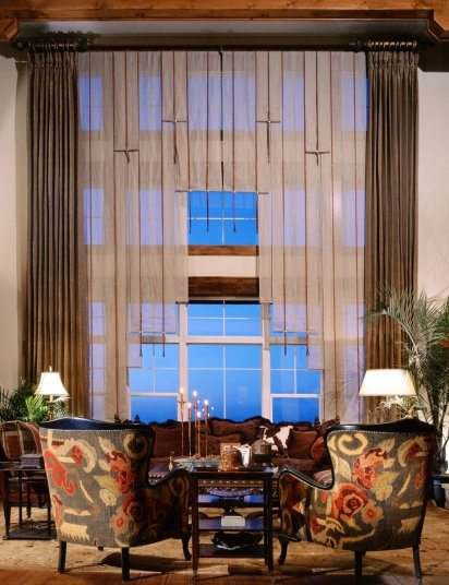 living room with architectural window treatments