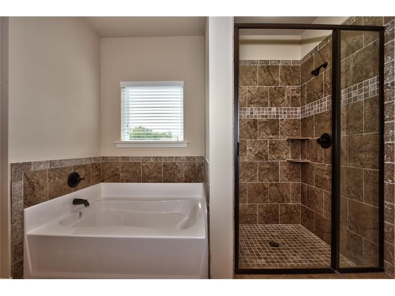 Boxley master bath tub and shower