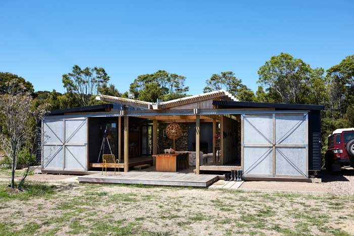 Two prefabs bookend an outdoor room