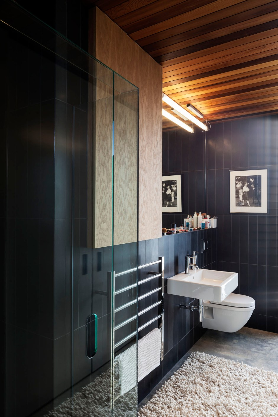 Gerrad Hall townhouse oiled ceiling and honed basalt create texture for en-suite