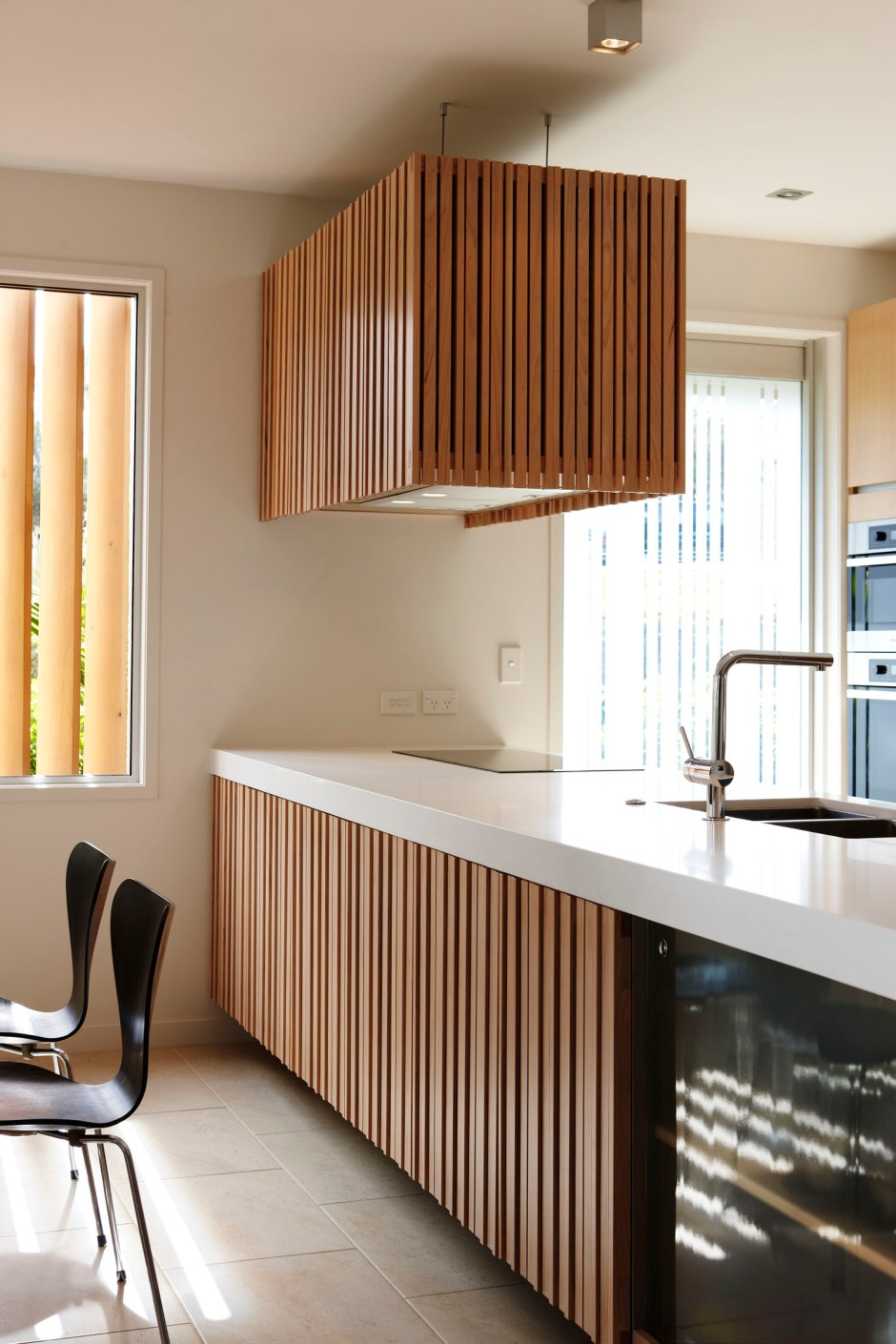 Dave Strachan townhouse kitchen links with exterior timber slats