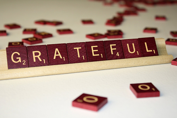 grateful letter on scrabble board