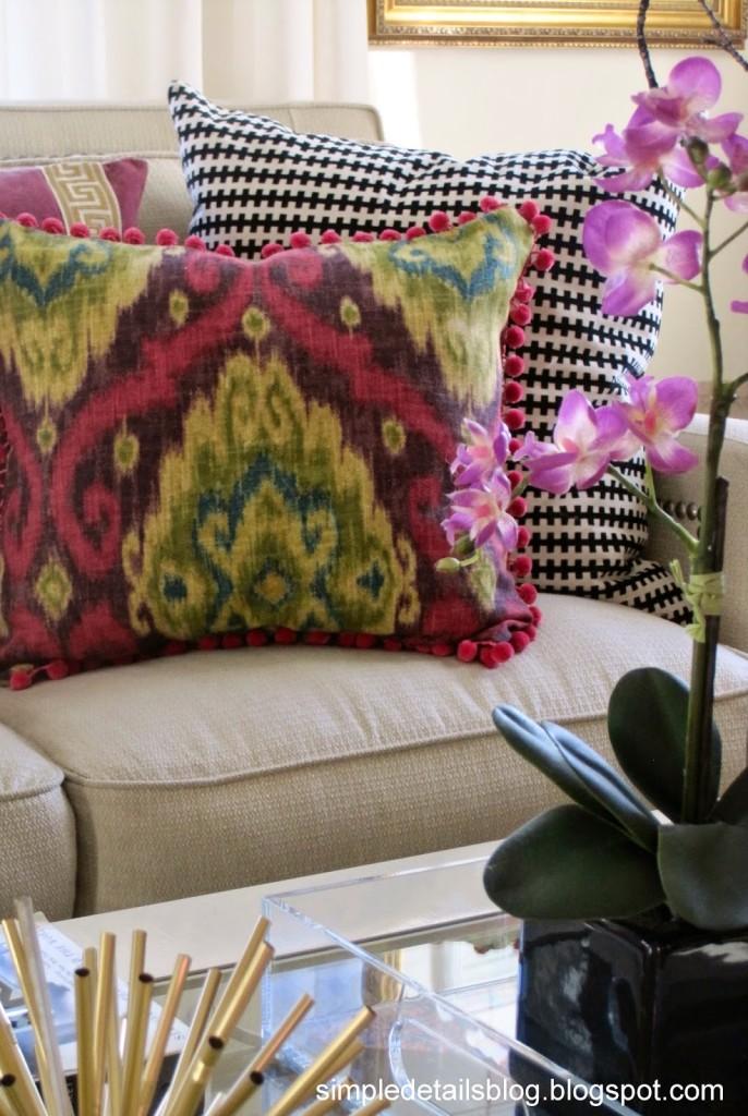 Raspberry Ikat pillow with pom pom fringe