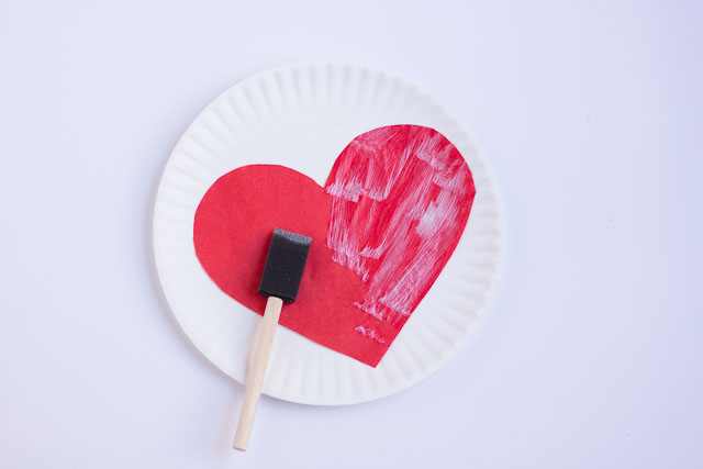 Make these DIY Valentine's Day heart balloons with Mod Podge and tissue paper!