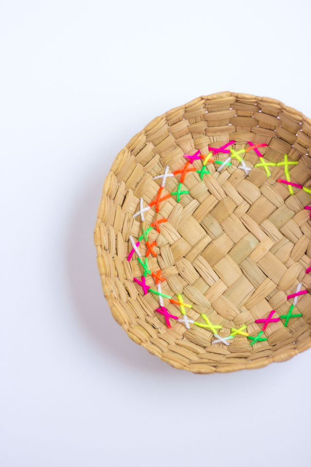 Give thrift store baskets a modern makeover by embroidering them with colorful yarn!