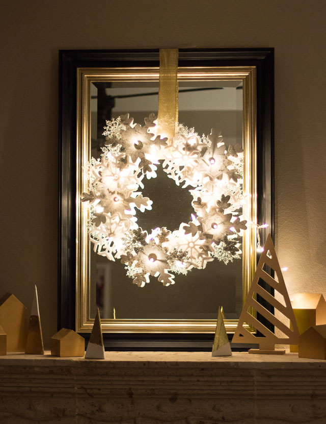 Glowing snowflake wreath hung over a mirror