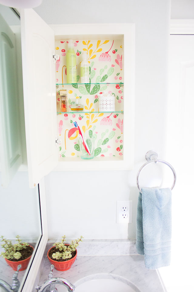 Makeover a medicine cabinet with peel and stick wallpaper!