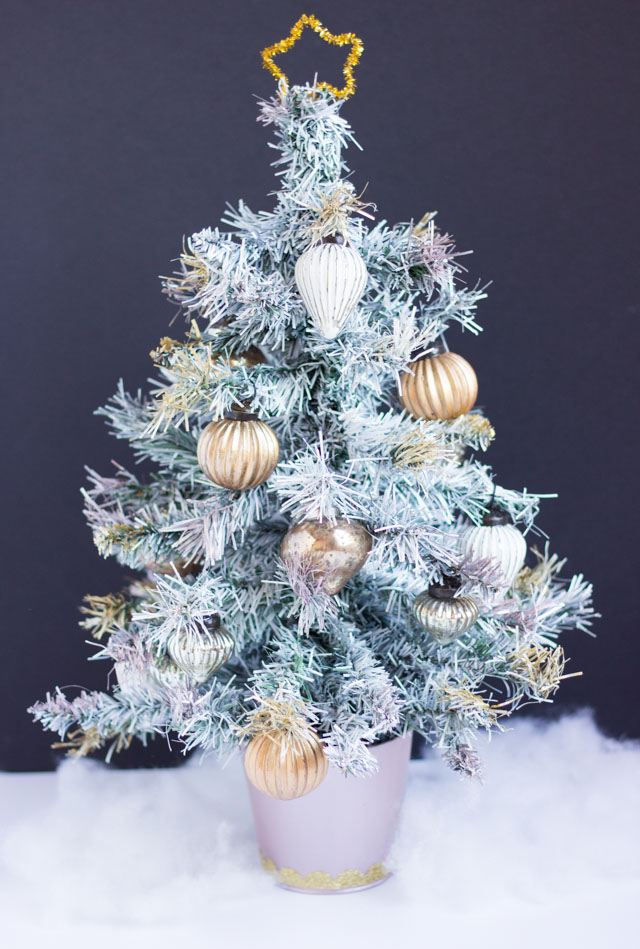 Tabletop painted Christmas tree with metallic ornaments