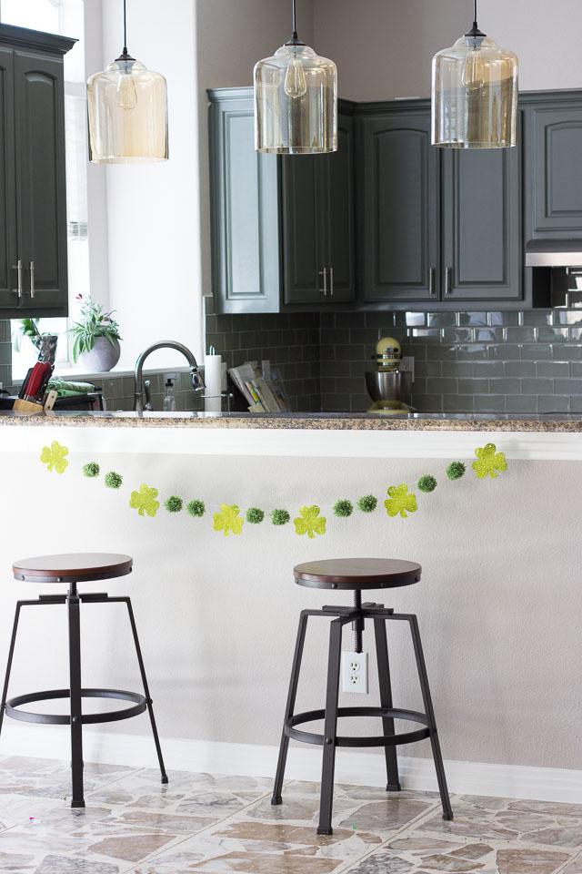 Pom-poms and shamrocks make the perfect stylish St. Patrick's day garland!