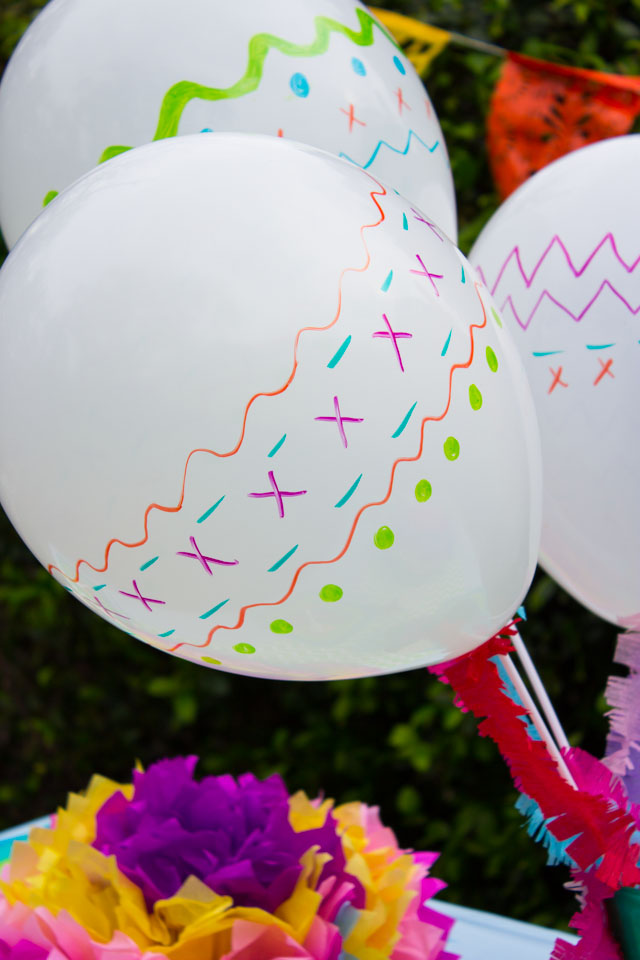 Fiesta balloons! Just doodle on with Sharpies to make them look like maracas!