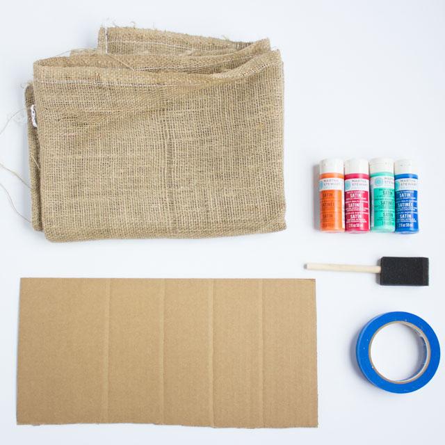 Supplies for DIY painted potato sacks