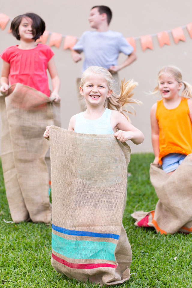 Have a backyard field day party with potato sack races!