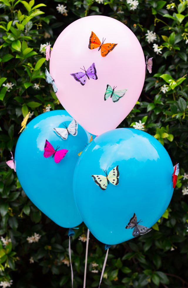 Add colorful feather butterflies to balloons for a gorgeous effect! Perfect for summer parties, shower, or wedding decor!