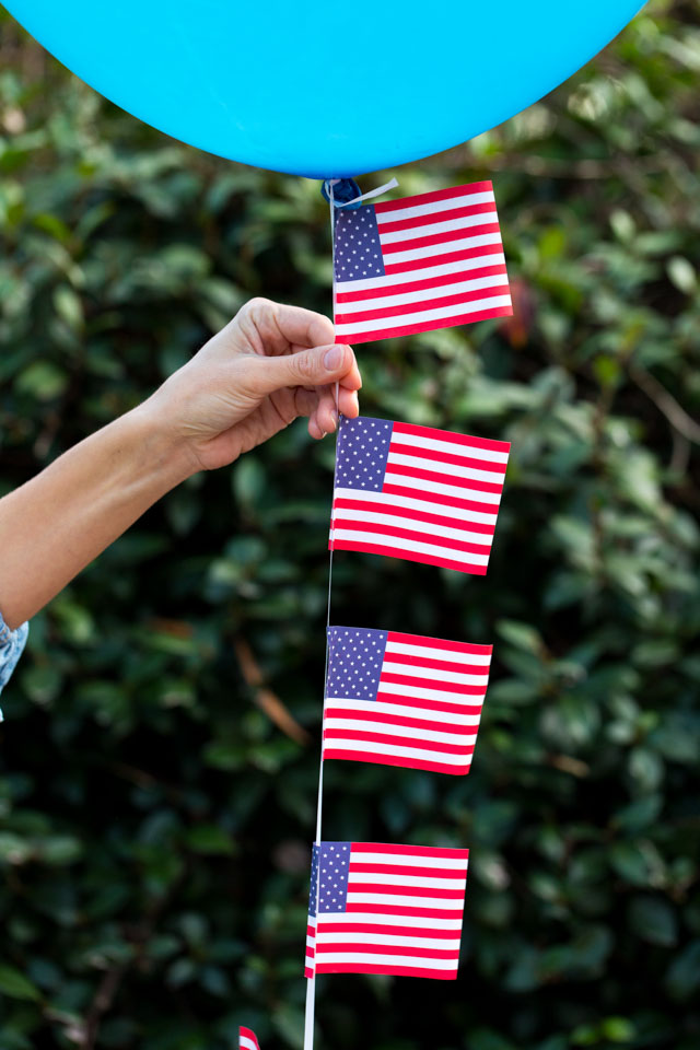 Decorate 4th of July balloons with small American flags!