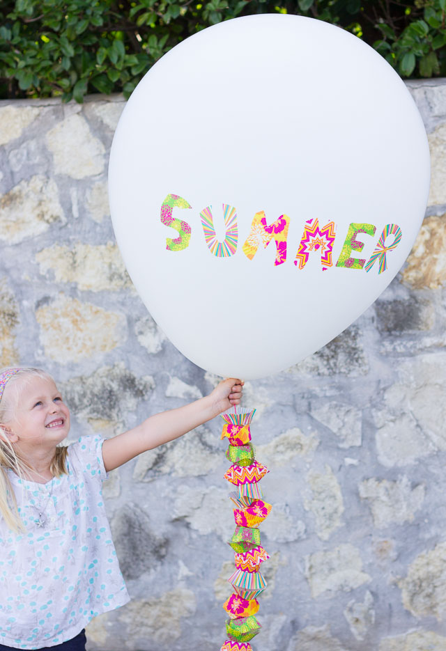 Decorate balloons with cupcake wrappers!