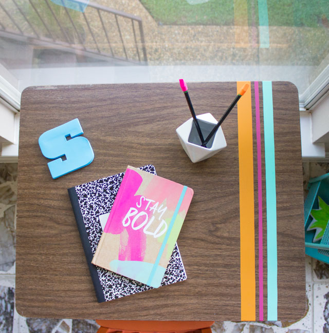 Love this vintage school desk decorated with strips of vinyl!