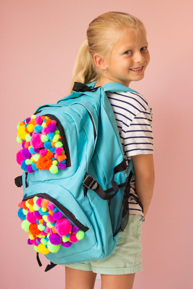 Make a pom-pom backpack for a fun back-to-school craft!