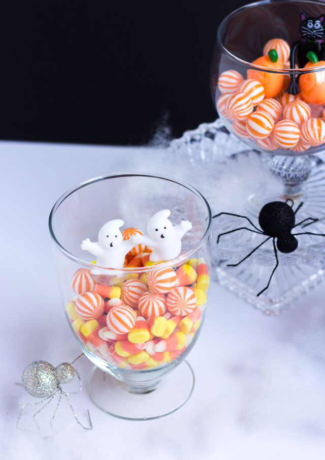 Fill glass jars with candy and small figurines for fun Halloween decor!