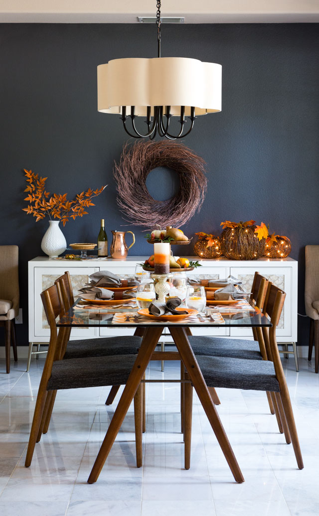 Love this moody fall dining room with harvest decor and metallic touches!